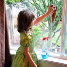girl-cleaning-window